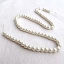 Perle nacrée 6mm écru - Fil de 72 perles